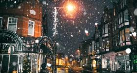 Snowing in a town centre