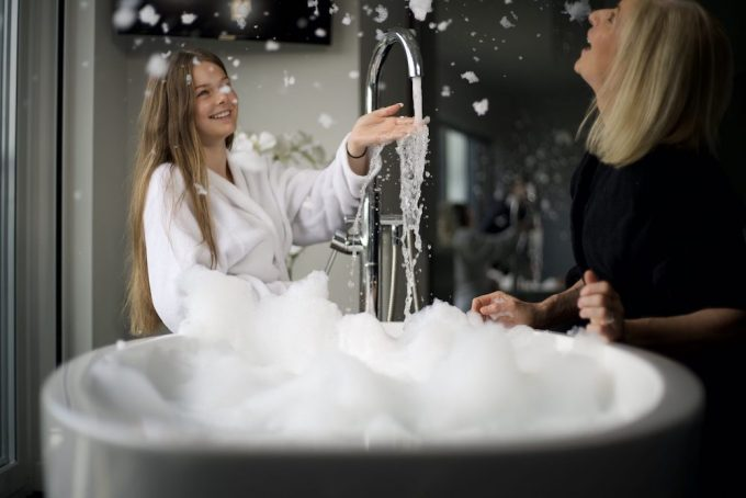 Woman and child bubble bath