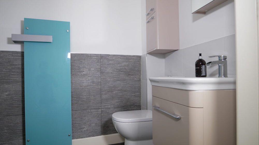 Radiator with towel rack in bathroom