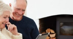 Couple smiling at tablet
